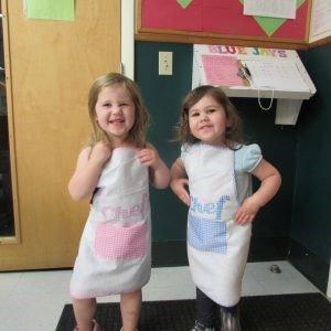 Toddlers making snacks