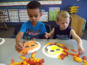 kids making arts and crafts pictures