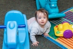Toddler crawling at the Pittsford location